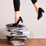 women in heels standing on files